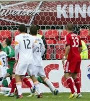 Houston Dynamo's Warren Creavalle, left, heads the ball past Toronto FC 's Joseph Bendik to tie the game in stoppage time during second half MLS action in Toronto on Saturday April 20, 2013.  (AP Photo/The Canadian Press, Chris Young)