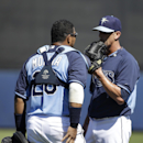 Tampa Bay Rays pitcher Grant Balfour, right, speaks with catcher Jose Molina, left, in the third inning of a spring exhibition baseball game against the Minnesota Twins, Sunday, March 2, 2014, in Port Charlotte, Fla. The Rays won 6-3 The Associated Press