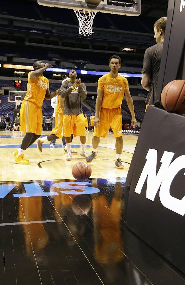 Tennessee players warm up during practice for their NCAA Midwest Regional semifinal college basketball tournament game Thursday, March 27, 2014, in Indianapolis. Tennessee plays Michigan on Friday, March 28, 2013