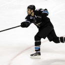In this Jan. 2, 2014 file photo, San Jose Sharks' Dan Boyle (22) shoots against the Edmonton Oilers during an NHL hockey game in San Jose, Calif. The New York Rangers have boosted their bid to make another postseason run. Defenseman Dan Boyle agreed to te