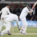 England's Jonathan Trott plays a shot off the bowling of New Zealand's Kane Williamson in their first test match, at Lord's cricket ground in London, Saturday, May 18, 2013. (AP Photo/Kirsty Wigglesworth)