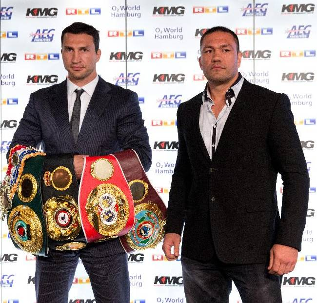 IBF , WBO and  WBA heavyweight boxing world  champion, Ukraine's Wladimir Klitschko  and his challenger Bulgaria's  Kubrat Pulev , right, pose after a press conference in Hamburg, northern Germany, Wednesday June 25, 2014.  Klitschko will face Pulev in a  title bout on Sept. 6, 2014 in Hamburg