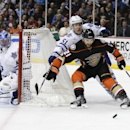 Anaheim Ducks right wing Kyle Palmieri, right front, battles Toronto Maple Leafs defenseman Jake Gardiner (51) for the puck as goalie Jonathan Bernier watches during the second period of an NHL hockey game in Anaheim, Calif., Wednesday, Jan. 14, 2015 The