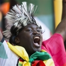 A supporter for Ghana sings during the Under-20 World Cup Group A soccer match between France and Ghana, in Istanbul, Turkey, Friday, June 21, 2013. (AP Photo/Gero Breloer)
