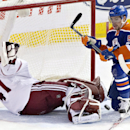 Arizona Coyotes goalie Mike Smith (41) makes the save as Edmonton Oilers' David Perron (57) battles for the puck in front of the goal during the second period of an NHL hockey game in Edmonton, Alberta, on Monday, Dec. 1, 2014 The Associated Press