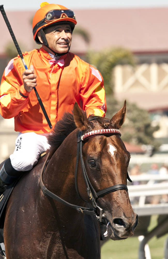 Tom's Tribute and jockey Mike Smith win the Grade I $300,000 Eddie Read Stakes on Sunday, July 20, 2014, at the Del Mar Thoroughbred Club, in Del Mar, Calif