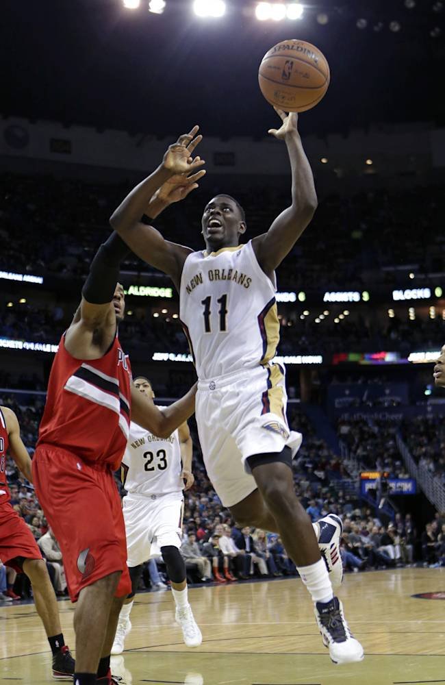 New Orleans Pelicans guard Jrue Holiday (11) drives to the basket in the second half of an NBA basketball game against the Portland Trail Blazers in New Orleans, Monday, Dec. 30, 2013. The Pelicans won 110-108