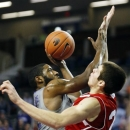 South Dakota forward Tyler Flack (23) defends a shot by Kansas State guard Omari Lawrence (12) during the first half of an NCAA college basketball game in Manhattan, Kan., Monday, Dec. 31, 2012. (AP Photo/Orlin Wagner)