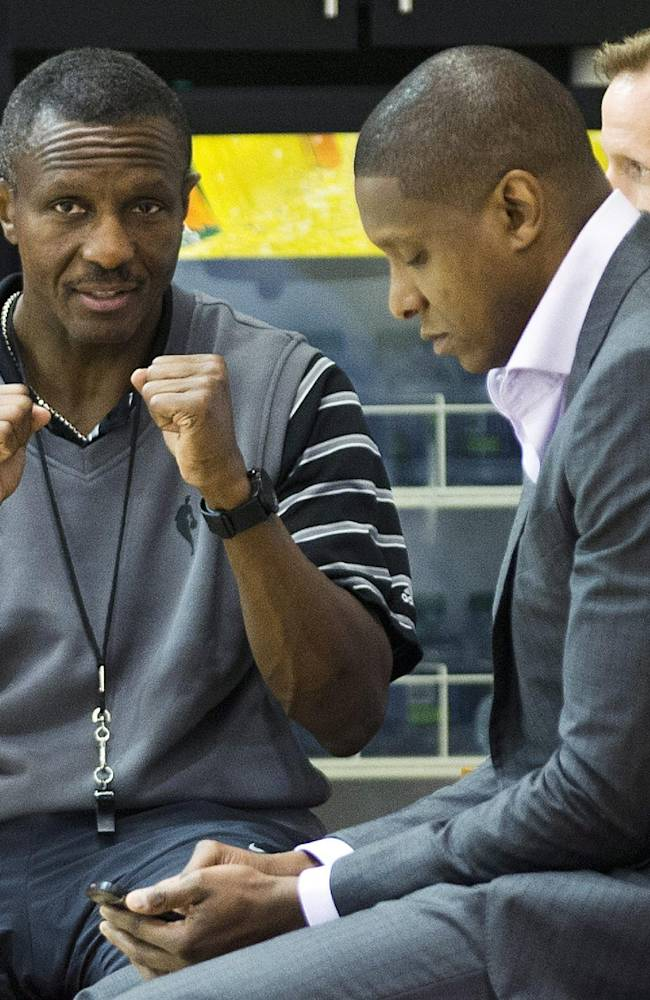 Toronto Raptors head coach Dwane Casey, left, talk with Raptors general manager Masai Ujiri during NBA basketball training camp in Toronto on Wednesday, Oct. 2, 2013