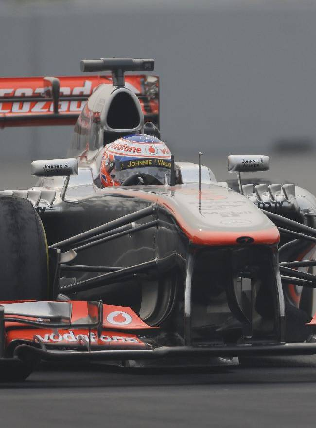 McLaren Mercedes driver Jenson Button of Britain steers his car during the second practice session at the Indian Formula One Grand Prix at the Buddh International Circuit in Noida, India, Friday, Oct. 25, 2013