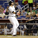 Miami Marlins' Jarrod Saltalamacchia tosses his bat after drawing a walk during the first inning of an interleague baseball game against the Seattle Mariners, Friday, April 18, 2014, in Miami The Associated Press