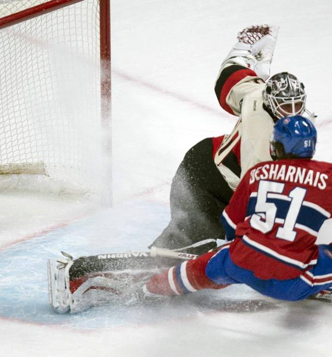 Ottawa Senators goalie Robin Lehner makes a save off Montreal Canadiens' David Desharnais, front, during the first period of an NHL hockey game Saturday, March 15, 2014, in Montreal