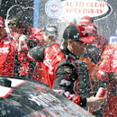 Kevin Harvick gets drenched by his team after winning the NASCAR Xfinity Sprint Cup Series auto race in Fontana, Calif., Saturday, March 21, 2015. (AP Photo/Alex Gallardo)