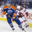 Arizona Coyotes' Tobias Rieder (8) chases Edmonton Oilers' Darnell Nurse (74) during the first period of an NHL hockey preseason game, Wednesday, Oct. 1, 2014, in Edmonton, Alberta. (AP Photo/The Canadian Press, Jason Franson)