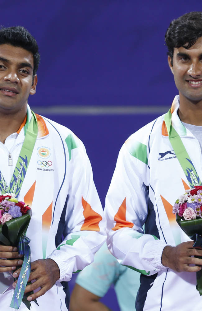 Bronze medal winners India's Divij Sharan, left, and Yuki Bhambri celebrate after winning the men's doubles tennis match at the 17th Asian Games in Incheon, South Korea, Monday, Sept. 29, 2014