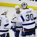 Tampa Bay Lightning goalie Ben Bishop (30), Ryan Callahan (24) and Cedric Paquette (13) celebrate after an NHL hockey game against the New York Rangers Monday, Nov. 17, 2014, in New York. The Lightning won the game 5-1 The Associated Press