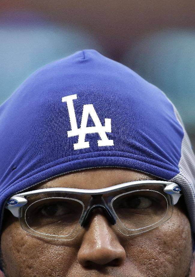 Los Angeles Dodgers' Ronald Belisario wears a hat during batting practice before Game 6 of the National League baseball championship series against the St. Louis Cardinals Friday, Oct. 18, 2013, in St. Louis