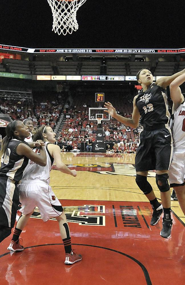 Louisville's Sara Hammond, right, has her shot blocked by Central Florida's Brittini Montgomery during the second half of an NCAA college basketball game on Wednesday, Jan. 15, 2014, in Louisville, Ky. Louisville defeated UCF 75-56