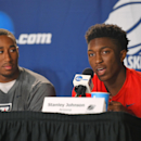 Arizona forward Stanley Johnson, right, answers a question as forward Rondae Hollis-Jefferson listens during a press conference at the NCAA college basketball tournament, Friday, March 27, 2015, in Los Angeles. Arizona plays Wisconsin in a regional final on Saturday. (AP Photo/Mark J. Terrill)