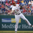 Washington Nationals third baseman Ryan Zimmerman throws to first base for the out on Miami Marlins' Casey McGehee during the fifth inning of a baseball game at Nationals Park Thursday, April 10, 2014, in Washington The Associated Press