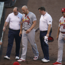 Cardinals' Holliday leaves Rockies game with leg injury The Associated Press