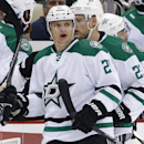 Dallas Stars' Antoine Roussel (21) returns to his bench after his goal in the second period of an NHL hockey game against the Pittsburgh Penguins in Pittsburgh, Thursday, Oct. 16, 2014 The Associated Press