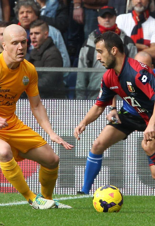 Genoa's Ioannis Fetfatzidis, right, vies for the ball with Verona's Verona's Emil Halfredsson during a Serie A soccer match between Genoa and Verona, in Genoa's Luigi Ferraris Stadium, Italy, Sunday, Nov. 10, 2013