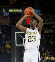 Michigan guard Caris LeVert (23) takes a shot in the first half of an NCAA college basketball game against South Carolina State in Ann Arbor, Mich., Tuesday, Nov. 12, 2013. (AP Photo/Tony Ding)