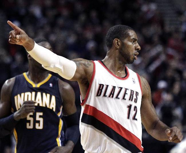 Portland Trail Blazers forward LaMarcus Aldridge gestures after scoring during the second half of an NBA basketball game against the Indiana Pacers in Portland, Ore., Monday, Dec. 2, 2013.  Aldridge led the Trail Blazers in scoring with 28 points and pulled in 10 rebounds as they beat the Pacers 106-102