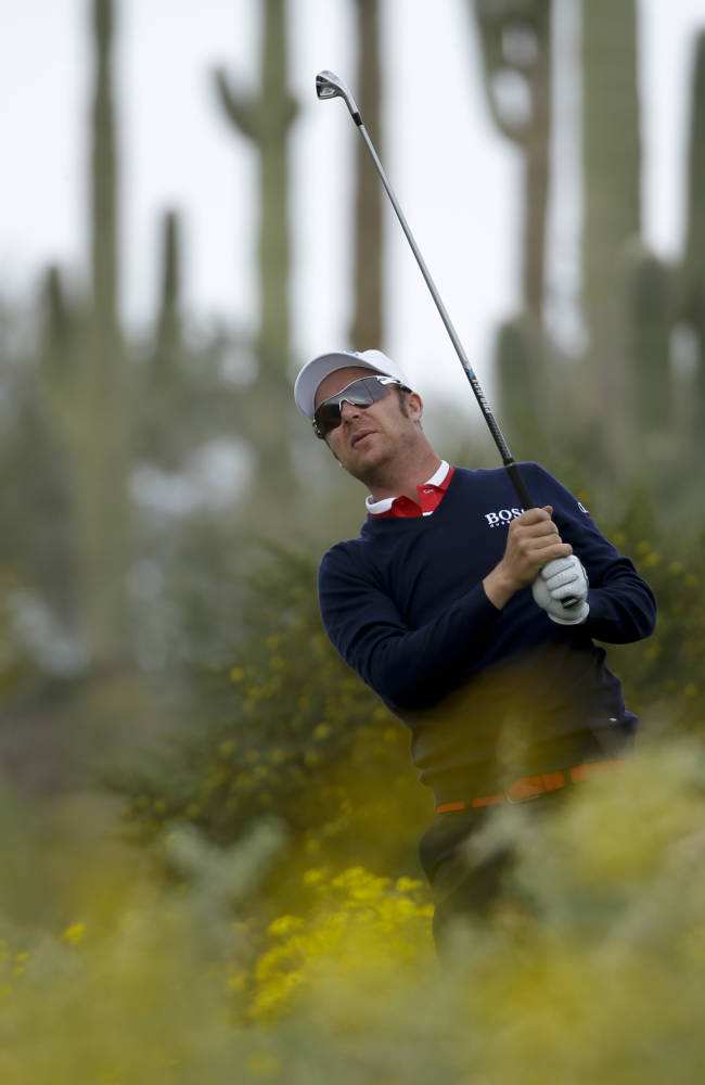 Mikko Ilonen, of Finland, hits his tee shot  on the 11th hole against Bubba Watson during the first round of the Match Play Championship golf tournament on Wednesday, Feb. 19, 2014, in Marana, Ariz