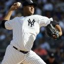 New York Yankees starting pitcher Ivan Nova throws against theTampa Bay Rays in the first inning of a baseball game, Saturday, Sept. 15, 2012, at Yankee Stadium in New York. (AP Photo/Kathy Kmonicek)
