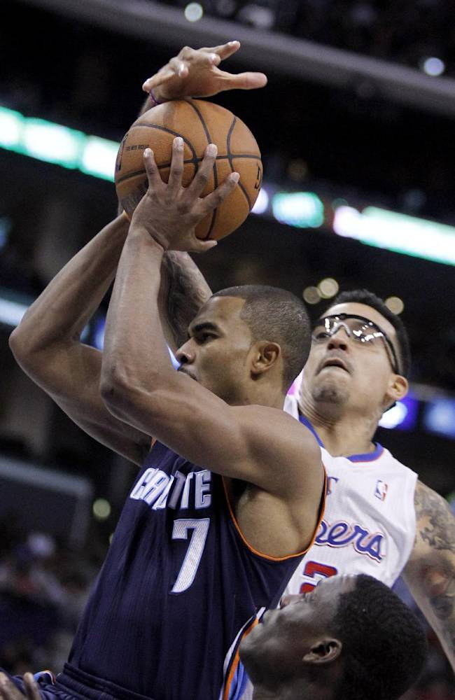 Los Angeles Clippers forward Matt Barnes, right, gets his hand on the ball on a shot by Charlotte Bobcats guard Ramon Sessions (7) during the second half of an NBA basketball game Wednesday, Jan. 1, 2014, in Los Angeles. The Clippers won 112-85