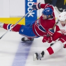 Montreal Canadiens' Max Pacioretty, left, collides with Detroit Red Wings' Danny DeKeyser during the first period of an NHL hockey game in Montreal, Saturday, April 5, 2014 The Associated Press