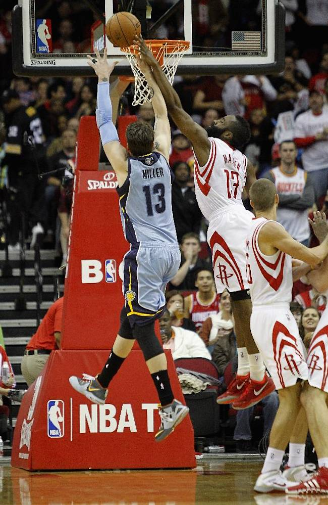 Memphis Grizzlies forward Mike Miller (13) has his shot blocked by Houston Rockets' James Harden (13) as he drives to the basket during the second half of an NBA basketball game Thursday, Dec. 26, 2013, in Houston