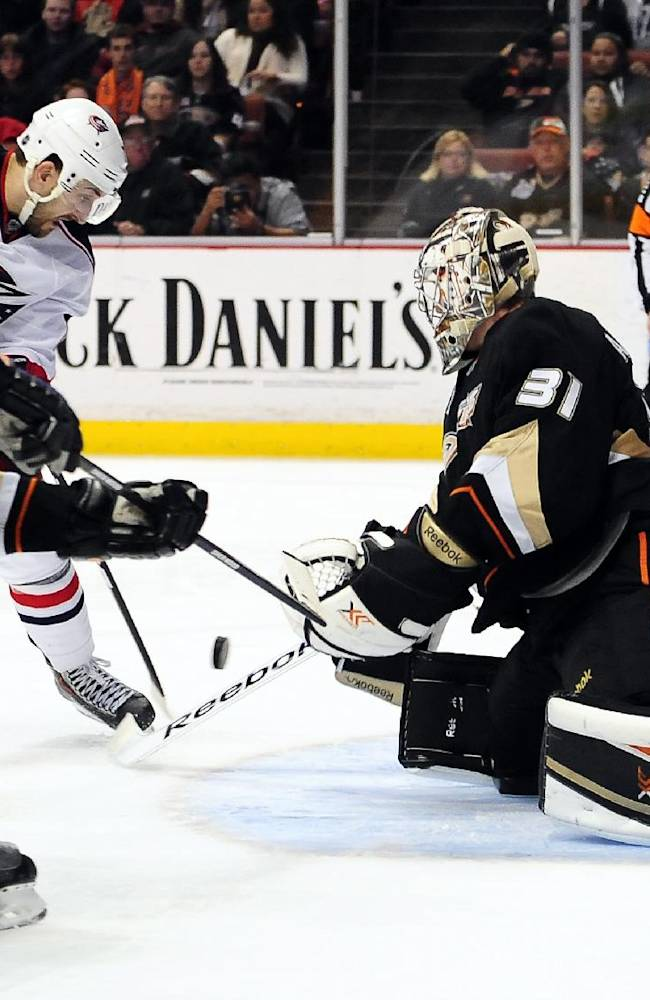 Columbus Blue Jackets left wing Nick Foligno scores on Anaheim Ducks defenseman Francois Beauchemin (23) and goalie Frederik Andersen (31) during the third period of an NHL hockey game, Monday, Feb. 3, 2014, in Anaheim, Calif. The Blue Jackets won 4-2