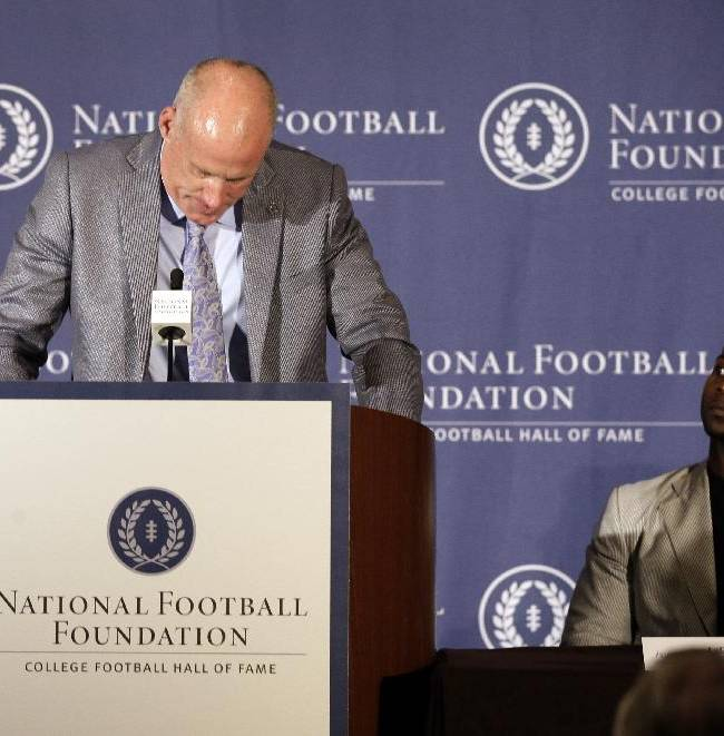 Former Penn State linebacker Shane Conlan, left, becomes emotional when talking about coach Joe Paterno as  former TCU tailback LaDainian Tomlinson, watches during a National Football Foundation College Football Hall Of Fame news conference, Thursday, May 22, 2014, in Irving, Texas