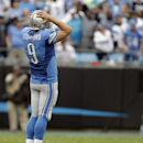 Detroit Lions' Matthew Stafford (9) reacts after a dropped pass against the Carolina Panthers during the first half of an NFL football game in Charlotte, N.C., Sunday, Sept. 14, 2014 The Associated Press