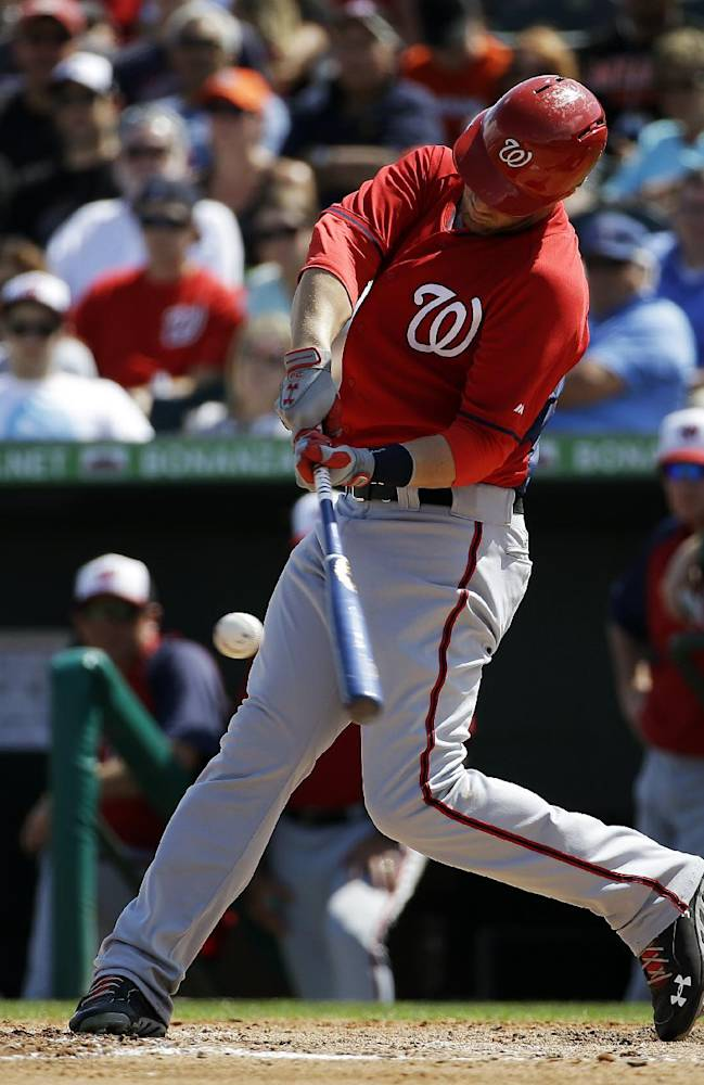Washington Nationals' Bryce Harper hits a single in the seventh inning of an exhibition spring training baseball game against the Miami Marlins, Saturday, March 15, 2014, in Jupiter, Fla