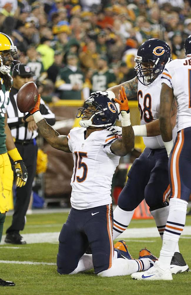 Chicago Bears' Brandon Marshall celebrates after a touchdown reception during the first half of an NFL football game against the Green Bay Packers Monday, Nov. 4, 2013, in Green Bay, Wis