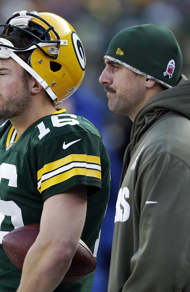 Green Bay Packers' Aaron Rodgers and Scott Tolzien watch from the sidelines during the second half of an NFL football game against the Philadelphia Eagles Sunday, Nov. 10, 2013, in Green Bay, Wis. The Eagles won 27-13