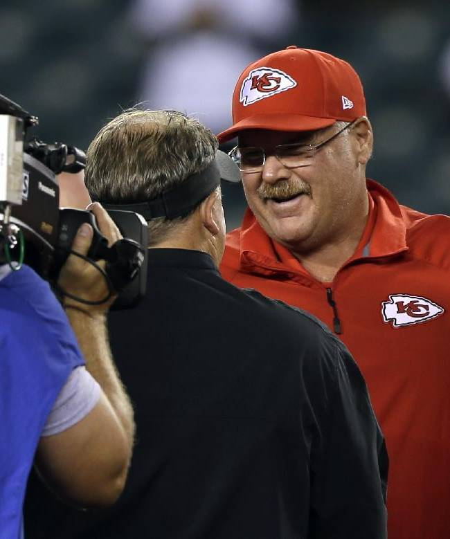 Kansas City Chiefs coach Andy Reid, right, meets with Philadelphia Eagles coach Chip Kelly before an NFL football game, Thursday, Sept. 19, 2013, in Philadelphia