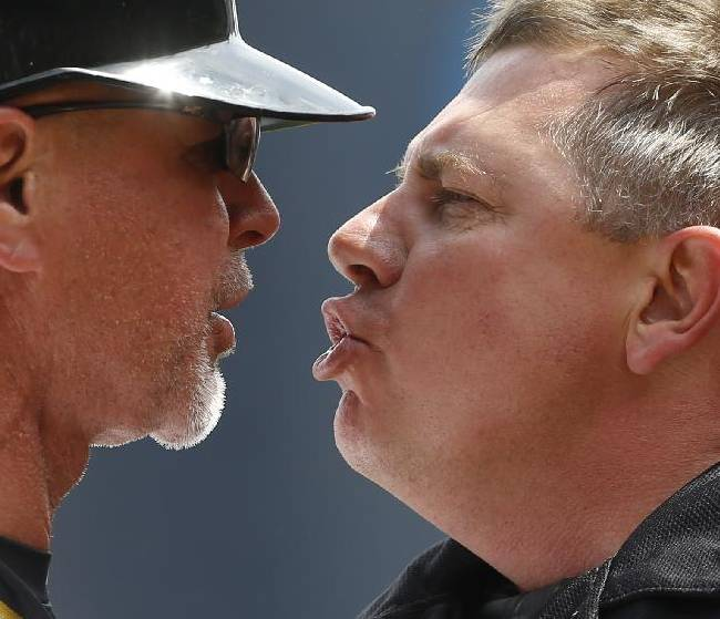 Home plate umpire Greg Gibson, right, argues with Pittsburgh Pirates first base coach Rick Sofield after a third strike call to end the fourth inning of a baseball game against the Toronto Blue Jays, Sunday, May 4, 2014, in Pittsburgh. Sofield was ejected