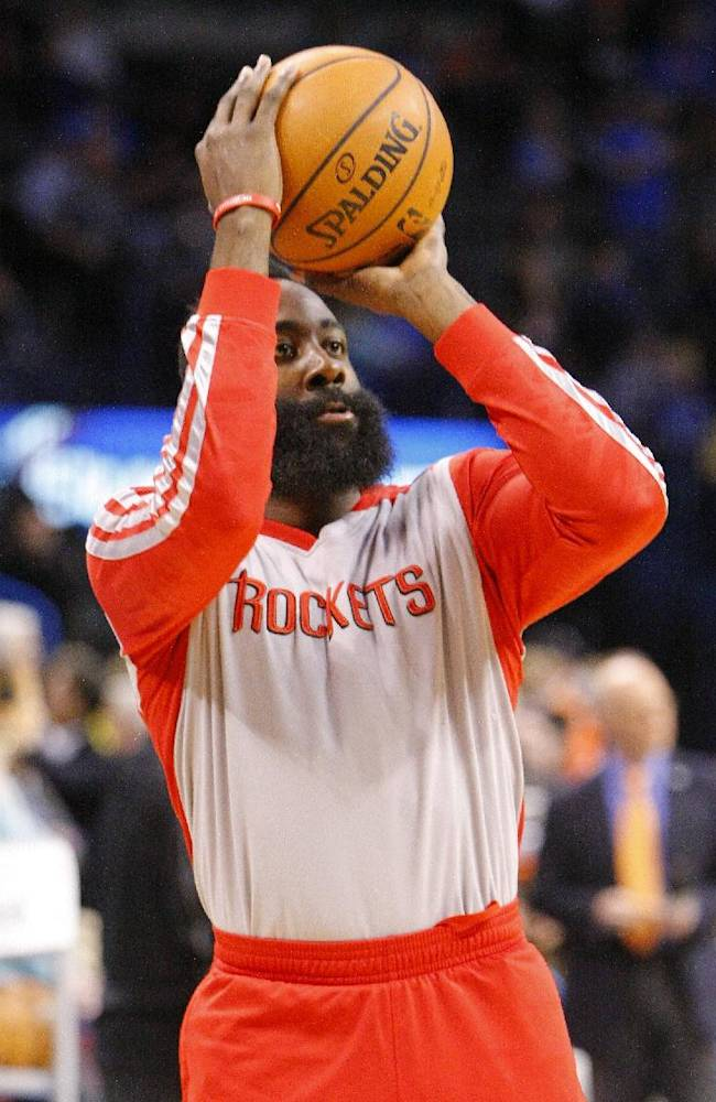 Houston Rockets guard James Harden warms up before the start of an NBA basketball game against the Oklahoma City Thunder, Sunday, Dec. 29, 2013, in Oklahoma City