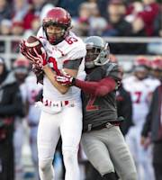 Utah wide receiver Sean Fitzgerald (83) catches a pass while covered by Washington State cornerback Nolan Washington (2) during the first half of an NCAA college football game Saturday, Nov. 23, 2013, at Martin Stadium in Pullman, Wash. (AP Photo/Dean Hare)