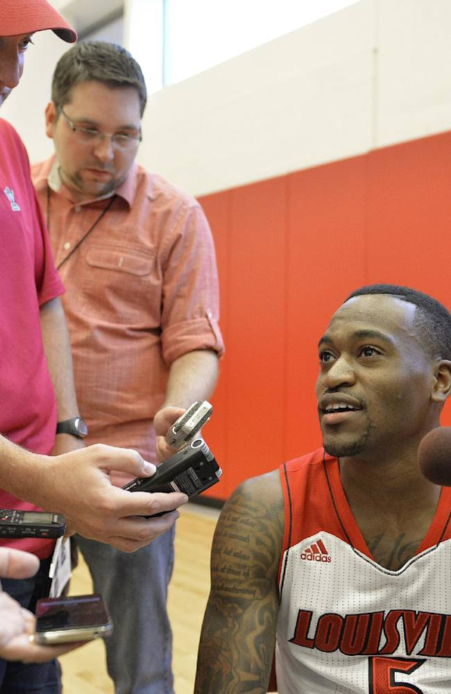 Louisville's Kevin Ware, right, is interviewed by reporters during NCAA college basketball media day, Saturday, Oct. 12, 2013, in Louisville, Ky