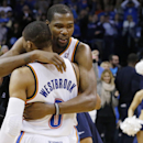 Oklahoma City Thunder forward Kevin Durant, right, hugs teammate Russell Westbrook (0) after an NBA basketball game against the Golden State Warriors in Oklahoma City, Friday, Nov. 29, 2013. Oklahoma City won 113-112. Westbrook hit a three-point basket ju