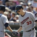 Minnesota Twins' Justin Morneau, right, congratulates teammate Joe Mauer after Mauer's solo home run during the first inning off Detroit Tigers starting pitcher Doug Fister in a baseball game in Detroit, Saturday, May 25, 2013. (AP Photo/Carlos Osorio)