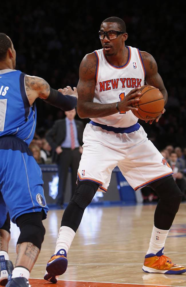 New York Knicks' Amar'e Stoudemire (1) controls the ball against Dallas Mavericks' Monta Ellis during the first half of an NBA basketball game, Monday, Feb. 24, 2014, in New York. Dallas won 110-108