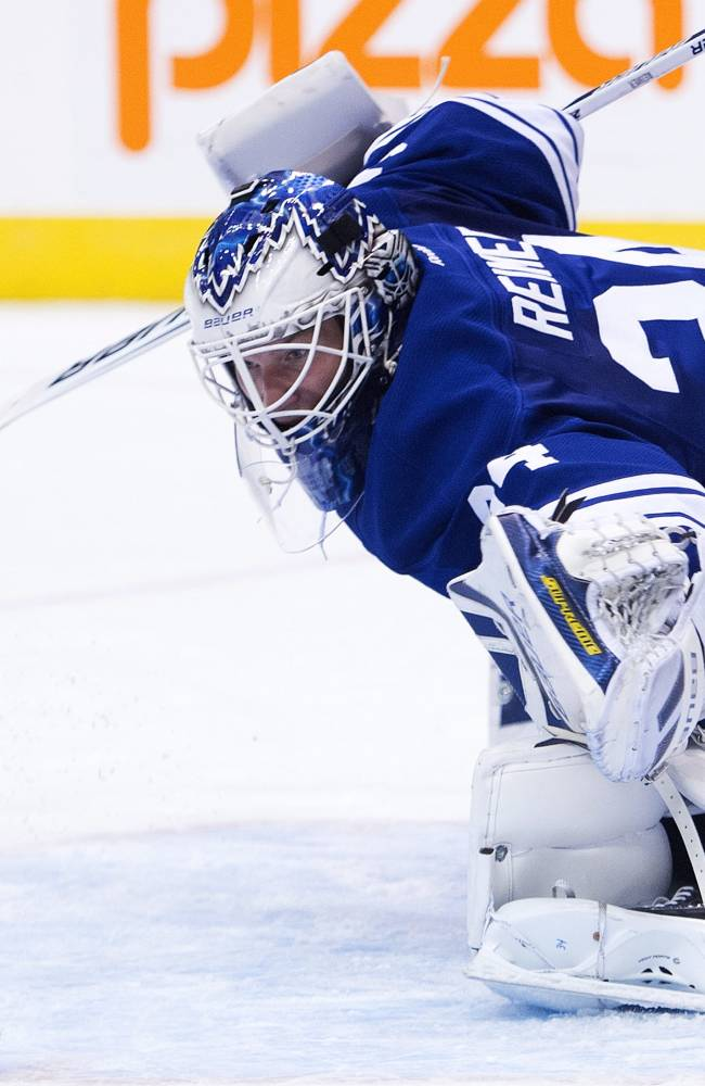 Toronto Maple Leafs goalie James Reimer makes a save against the Pittsburgh Penguins during the first period of an NHL hockey game, Saturday, Oct. 26, 2013 in Toronto
