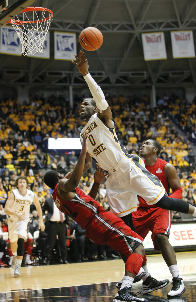 Wichita State's Chadrack Lufile goes for a shot over Western Kentucky's T.J. Price during the first half of their NCAA college basketball game on Tuesday, Nov. 12, 2013 at Charles Koch Arena in Wichita, Kan. Wichita State defeated Western Kentucky 66-49